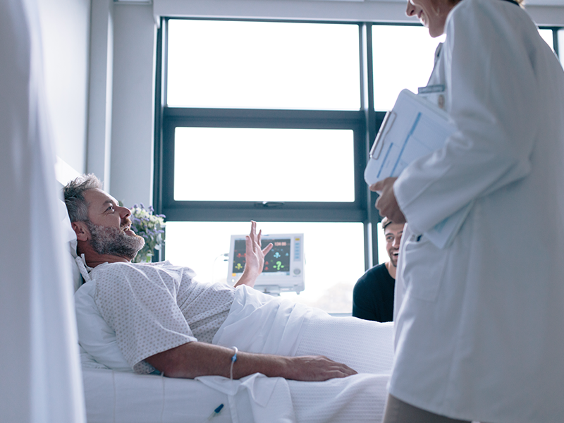 hospital patient talking with doctor