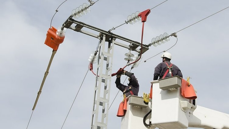 Electrical Engineers fixing issue on the electric pole