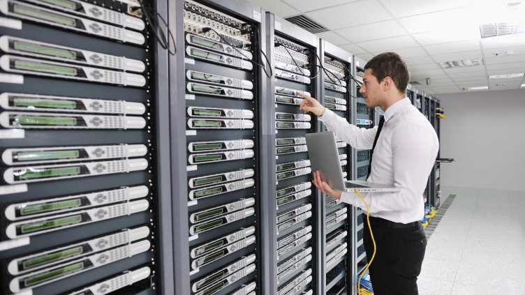 Engineer working on servers in data center