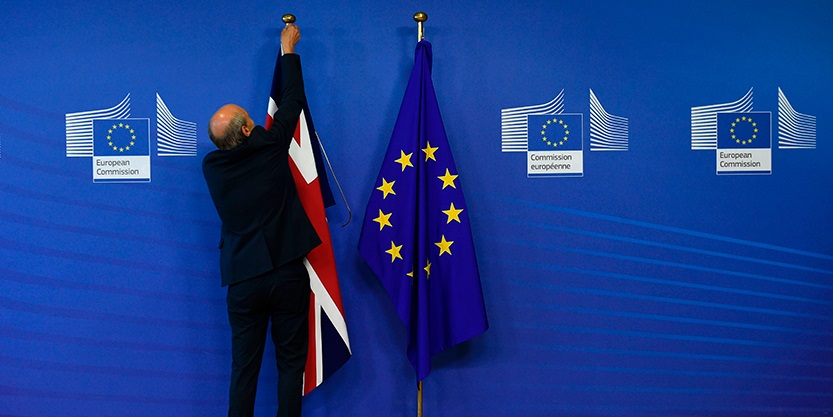Man is taking down UK flag
