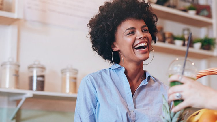 woman laughing in coworking kitchen