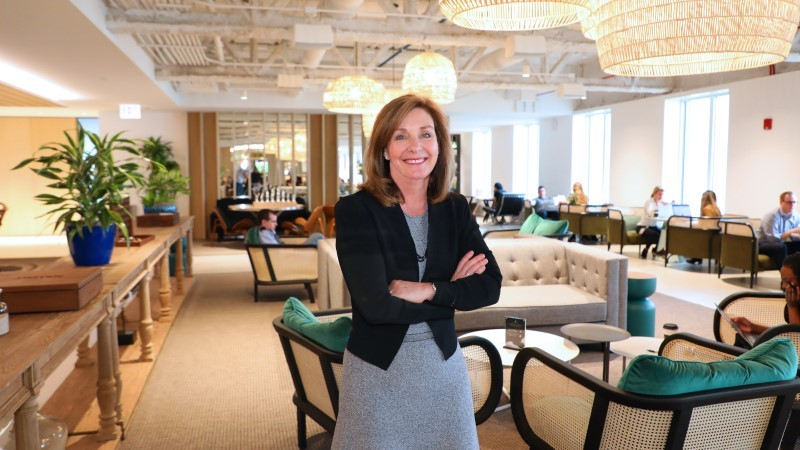 JLL Global CHRO Mary Bilbrey inside Aon Center's Cloud Level in Chicago
