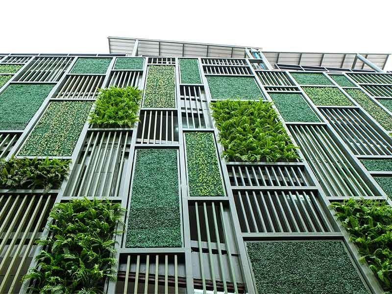 Upward view of building with greenery