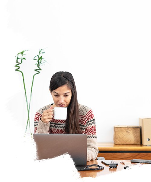 woman having coffee working on laptop