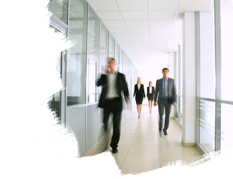 Business People Walking Through Office Corridor